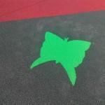 Цветная вставка в покрытие для детской игровой площадки